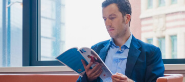 Man looking through a Kaplan study text